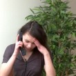 Irritate womtalking on phone — Stok Video #15400597
