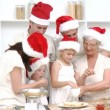 Stock Video: Family doing their Christmas baking in the kitchen