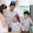 Royalty-Free Stock Imagem Vetorial: Family celebrating a birthday in the kitchen