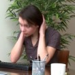 Stressed woman working at a computer — Stock Video