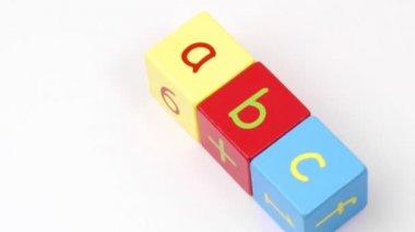 Colorful alphabet toy blocks spelling ABC turning — Stock Video