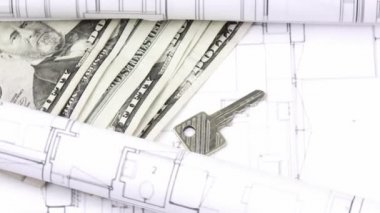 Close-up of plans, dollars and keys turning — Stock Video