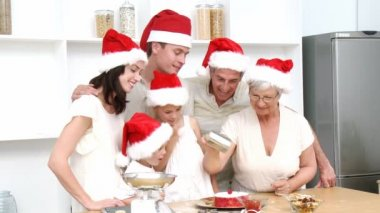 Family doing their Christmas baking in the kitchen — Stock Video