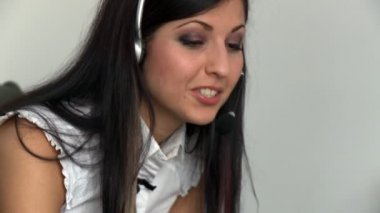 Portrait of a pretty woman talking with headset on — Stock Video