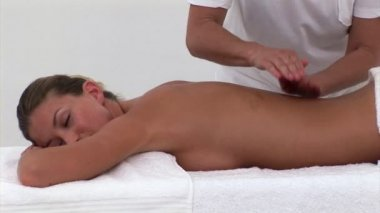 Relaxed woman enjoying a back massage — Stock Video