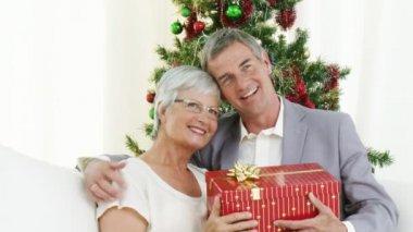 Happy Grandparents holding christmas presents — Stock Video