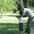 Father teaching his son how to play baseball — Stock Video #15412867
