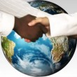 Stock Video: Business shaking hands against world. Multicultural world and Solidarity concepts