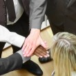 Close-up of business team with hands together and blonde businesswoman smiling at the camera  — Stock Video