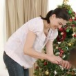 Stok video: Mother and little girl decorating Christmas tree
