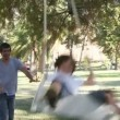 Father and son swinging in park — Stock Video #15419123