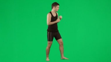 Young man boxing against green screen footage — Stock Video