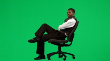 Afro-American businessman relaxing on a chair footage — Stock Video