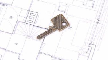 Close-up of a house plan and a key turning — Stock Video