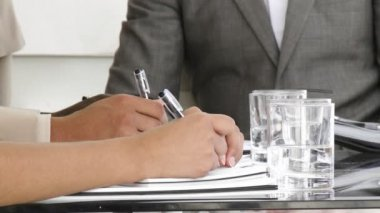 Close-up of multi-ethnic business making notes — Stock Video