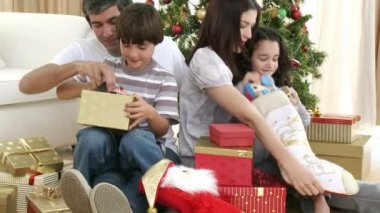 Parents and children opening Christmas presents — Stock Video