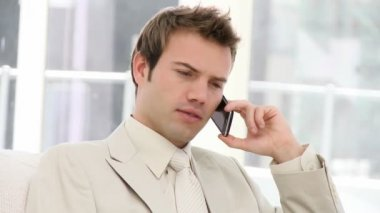 Charming businessman talking seriously on phone — Stock Video