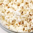 Bowl full of popcorn turning - Stock Photo