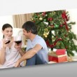 Loving families at Christmas time - Stock Photo