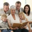 Grandparents with family at home - Stock Photo