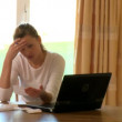 Stock Video: Pessimistic womdoing her accounts