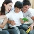 Family playing video Games at home - Stockfoto