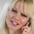 Stock Video: Attractive blonde woman on the phone