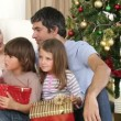 Parents and children holding Christmas presents at home — Stock Video