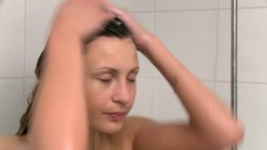 Peaceful woman taking a shower — Stock Video