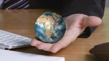 Businessman with a globe in his hand — Stock Video