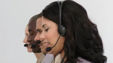 Smiling business team using headset — Stock Video