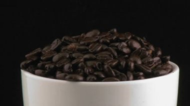 Cup with coffee beans — Stock Video