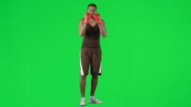 Afro-American man boxing against green screen footage — Stock Video