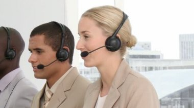 Multi-ethnic business with headset on — Stock Video