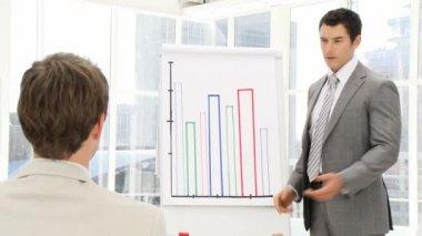 Elegant business man presenting statistics — Stock Video