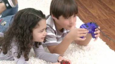 Children playing video games in the living-room — Stock Video