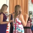 Attractive young women trying dresses looking at the mirror — Stok video