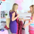 Bright women choosing dresses  — Video Stock