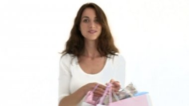 Happy hispanic woman holding shopping bags — Stock Video