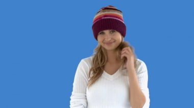 Charming caucasian woman with a colorful hat — Stock Video