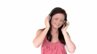 Radiant young woman listen to music wearing headphones — Stock Video