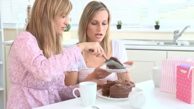 Jolly young women eating chocolate cake — Vídeo de stock