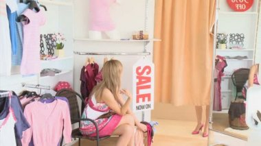 Young pretty women showing her friend a dress — Stock Video