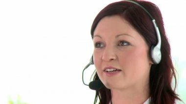Happy businesswoman using headset — Stock Video