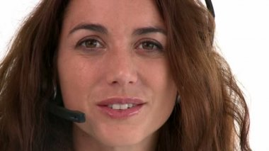 Cheerful hispanic businesswoman wearing headset — Stock Video
