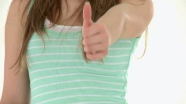 Close-up of a teenager doing a thumbs up — Stock Video