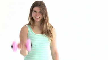 Attractive student holding dumbbells looking at the camera — Stock Video