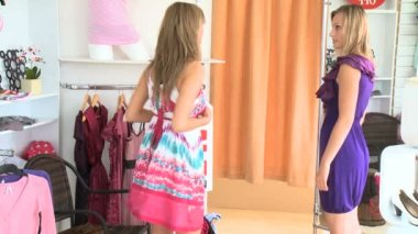 Charming women trying dresses together — Stock Video