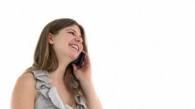 Merry young woman talking on phone against a white background
