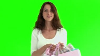 Cute hispanic woman holding shopping bags — Stock Video